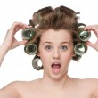 Woman curling her hair with roller — Stock Photo #8533837