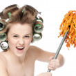 Angry woman in hair rollers is holding swab — Stock Photo #8533844