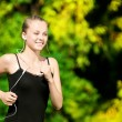 Young woman running in green park — Stock Photo #8533962