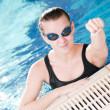 Woman in black goggles in swimming pool — Stock Photo #8534176