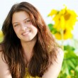 Beautiful woman in a sunflower field — Stock Photo