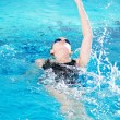 Royalty-Free Stock Photo: Swimmer in swim meet doing backstroke