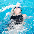 Swimmer in swim meet doing backstroke — Stock fotografie