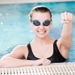 Woman in black goggles in swimming pool — Stock Photo #8534780