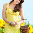 Beautiful woman in a sunflower field — Stock Photo #8534783