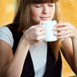 Woman sitting in a cafe with a coffe — Stock Photo #8534789