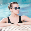 Woman in black goggles in swimming pool — Stock Photo