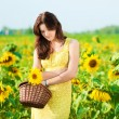 Beautiful woman in a sunflower field — Stock Photo #8534941