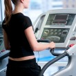 Young woman at the gym. Run on a machine — Stock Photo #8534993