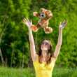 Beautiful young woman play with toy — Stock Photo #8534999