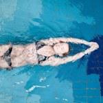 Swimmer in swim meet doing backstroke — Stock Photo #8535057