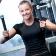 Young woman at the gym exercising — Stock Photo #8535066