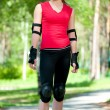 Beautiful woman rink on rollerskate in park - Stockfoto