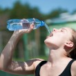 Yyoung woman drinking water after exercise — Stock Photo #8535080
