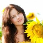 Beautiful woman in a sunflower field — Stock Photo #8535083