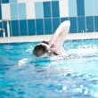Stock Photo: Swimmer womperforming crawl stroke
