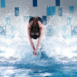Swimmer jumping in swimming pool — Stock Photo