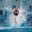 Swimmer jumping in swimming pool — Stock Photo #8535398