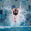 Stock Photo: Swimmer jumping in swimming pool