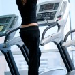 Young woman at the gym. Run on a machine - 