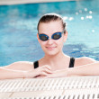 Woman in black goggles in swimming pool - 