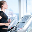 Young woman at the gym. Run on a machine — Stock Photo