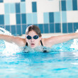 Swimmer performing the butterfly stroke - Стоковая фотография