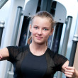 Young woman at the gym exercising — Stock Photo