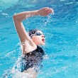 Swimmer performing the crawl stroke - Stock Photo