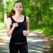 Beautiful woman running in green park — Stock Photo #8535818