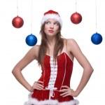 Closeup portrait of girl in santa dress and christmas balls — Stock Photo