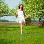 Beautiful young woman in apple tree garden — Stock Photo