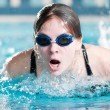 Swimmer performing the butterfly stroke — Foto de Stock