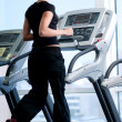 Young woman at the gym. Run on a machine — Stock Photo #8536014