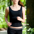 Woman running in green park — Stock Photo #8536016