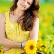 Beautiful woman in a sunflower field — Stock Photo #8536051