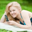 Woman texting on mobile phone — Stock Photo #8536057