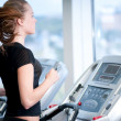 Young woman at the gym. Run on a machine — Stock Photo #8536073