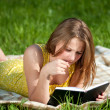 Beautiful young woman reading book outdoor — Stock Photo #8536078