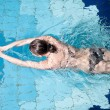 Royalty-Free Stock Photo: Athletic swimmer is diving in a swimming pool