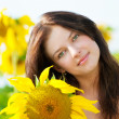 Beautiful woman in a sunflower field — Stock Photo #8536105