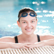 Woman in black goggles in swimming pool — Stock Photo #8536208