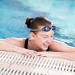 Woman in black goggles in swimming pool — Stock Photo #8536227