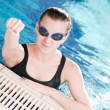 Woman in black goggles in swimming pool — Stock Photo #8536232