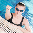 Woman in black goggles in swimming pool — Stock Photo #8536235