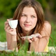 Beautiful young woman drink hot coffee outdoor — Stock Photo