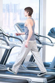 Young man at the gym exercising. Running — Stock Photo