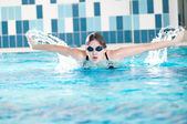 Swimmer performing the butterfly stroke — Stock Photo