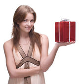 Beautiful girl with some gifts — Stock Photo