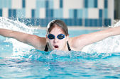 Swimmer performing the butterfly stroke — Стоковое фото